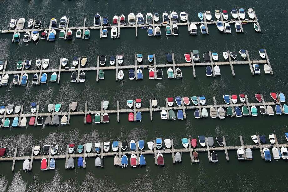 BUFFALO, NY - JUNE 04:  Boats await summer use at a Lake Erie marina on June 4, 2013 in Buffalo, New York, near the U.S.-Canada border. The aerial view was seen from a helicopter flown by the U.S. Office of Air and Marine, (OAM), which monitors and patrols the U.S.-Canada border. Photo: John Moore, Getty Images / 2013 Getty Images