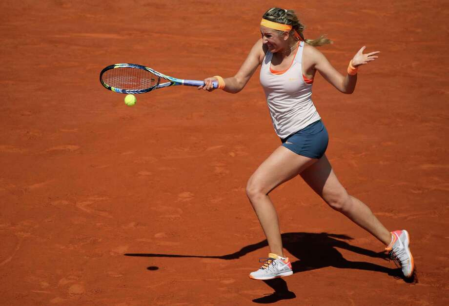 TOPSHOTS Belarus' Victoria Azarenka returns a shot to Russia's Maria Kirilenko during a French tennis Open quarter final match at the Roland Garros stadium in Paris on June 5, 2013. AFP PHOTO / KENZO TRIBOUILLARDKENZO TRIBOUILLARD/AFP/Getty Images Photo: KENZO TRIBOUILLARD, AFP/Getty Images / AFP