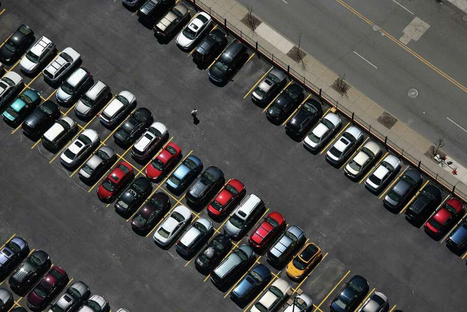 BUFFALO, NY - JUNE 04:  A man walks through a parking lot on June 4, 2013 in Buffalo, New York, near the U.S.-Canada border. The aerial view was seen from a helicopter flown by the U.S. Office of Air and Marine, (OAM), which monitors and patrols the U.S.-Canada border. Photo: John Moore, Getty Images / 2013 Getty Images