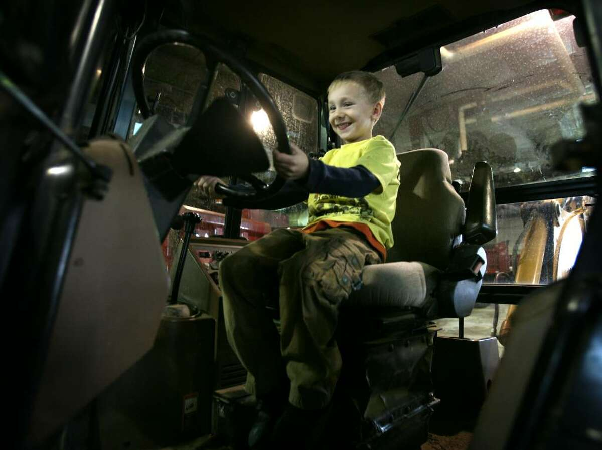 Dominic Del Re, 6 of Seymour, sits behind the wheel of a backhoe during a visit of homeschooled children to the Seymour Public Works Department on Wednesday, January 13, 2010 in Seymour, Conn.
