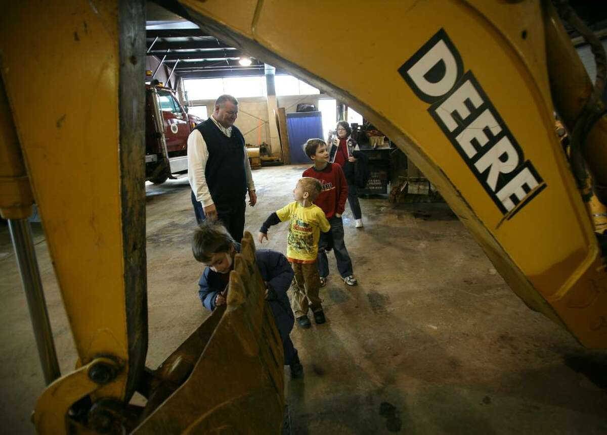 From left; Director of Public Works Dennis Rozum shows a backhoe to Evan Shail, 6 of Seymour, Dominic Del Re, 6 of Seymour, and Andrew Smyder, 8 of Stratford, during a visit of homeschooled children to the Seymour Public Works Department on Wednesday, January 13, 2010 in Seymour, Conn.
