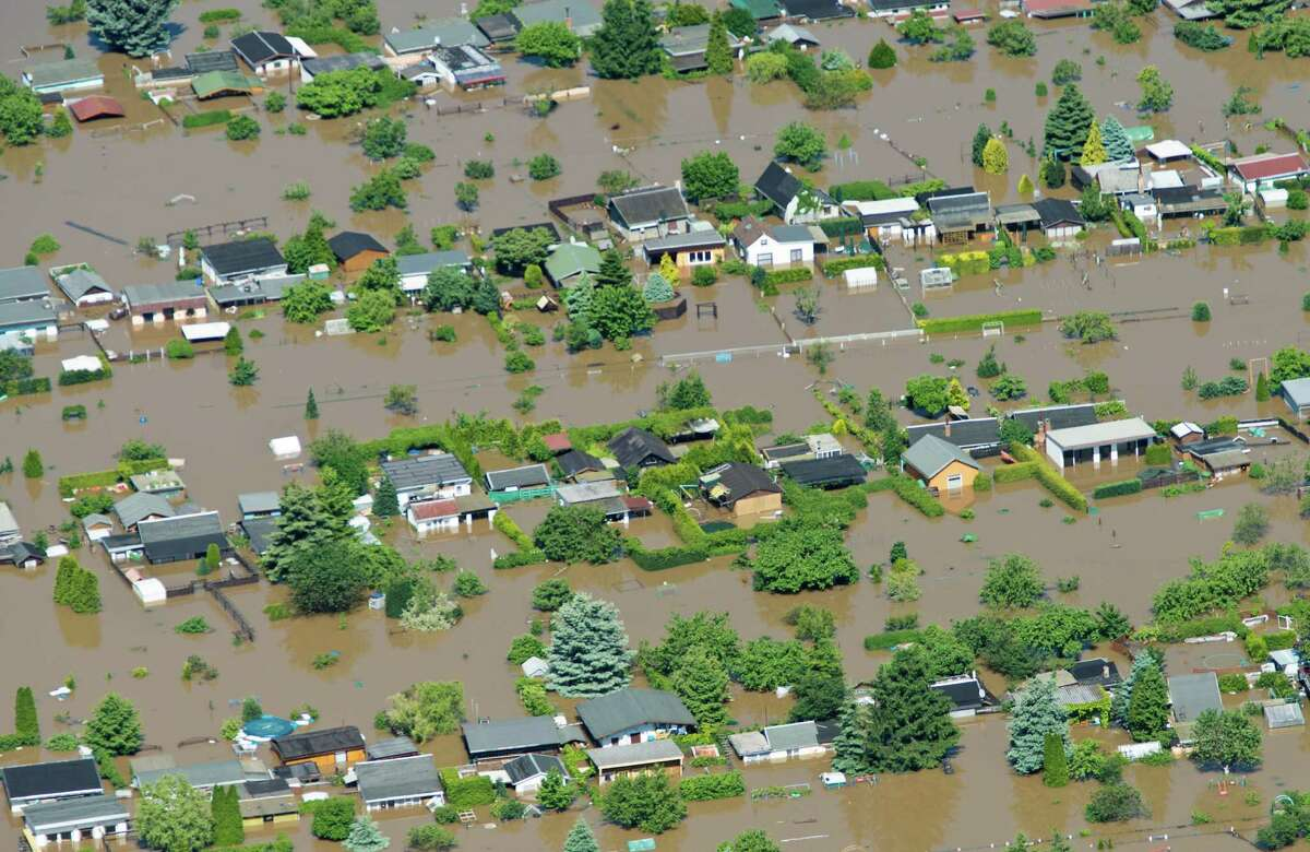In this aerial view picture houses stand in the floods of Elbe river in Riesa, Germany, Wednesday June 5, 2013. Heavy rainfalls caused flooding in parts of Germany, Austria and Czech Republic.