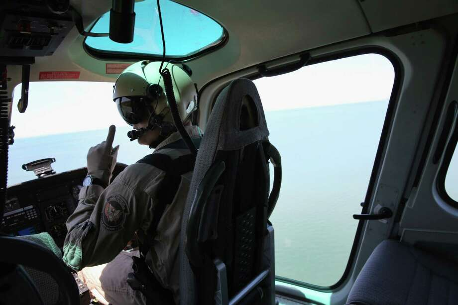 YOUNGSTOWN, NY - JUNE 04:  Helicopter pilot Ryan Anderson from the U.S. Office of Air and Marine (OAM), flies over Lake Ontario on June 4, 2013 near Youngstown, New York. The OAM patrols more than a 300 mile stretch of the border between the United States and Canada. Photo: John Moore, Getty Images / 2013 Getty Images