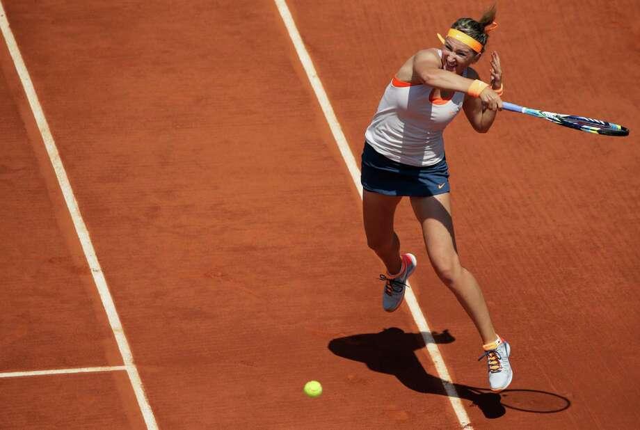 TOPSHOTS Belarus' Victoria Azarenka returns a shot to Russia's Maria Kirilenkoduring a French tennis Open quarter final match at the Roland Garros stadium in Paris on June 5, 2013.  AFP PHOTO / KENZO TRIBOUILLARDKENZO TRIBOUILLARD/AFP/Getty Images Photo: KENZO TRIBOUILLARD, AFP/Getty Images / AFP