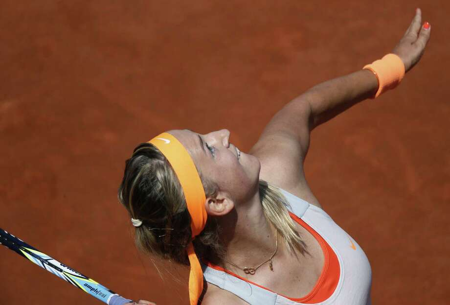 TOPSHOTS Belarus' Victoria Azarenka serves to Russia's Maria Kirilenko during a French tennis Open quarter final match at the Roland Garros stadium in Paris on June 5, 2013. AFP PHOTO / KENZO TRIBOUILLARDKENZO TRIBOUILLARD/AFP/Getty Images Photo: KENZO TRIBOUILLARD, AFP/Getty Images / AFP