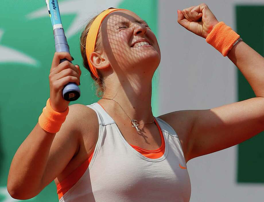 Belarus' Victoria Azarenka celebrates he win over Russia's Maria Kirilenko during their quarterfinal match of the French Open tennis tournament at the Roland Garros stadium Wednesday, June 5, 2013 in Paris. Azarenka won 7-6, 6-2. Photo: Michel Spingler, AP / AP