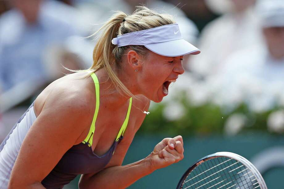 Russia's Maria Sharapova celebrates scoring against Serbia's Jelena Jankovic in their quarterfinal match at the French Open tennis tournament, at Roland Garros stadium in Paris, Wednesday June 5, 2013. Sharapova won in three sets 0-6, 6-4, 6-3. Photo: Petr David Josek, AP / AP