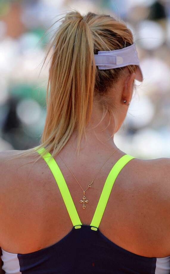 TOPSHOTS Russia's Maria Sharapova is seen during a French tennis Open quarter final match against Serbia's Jelena Jankovic at the Roland Garros stadium in Paris on June 5, 2013.  AFP PHOTO / MIGUEL MEDINAMIGUEL MEDINA/AFP/Getty Images Photo: MIGUEL MEDINA, AFP/Getty Images / AFP