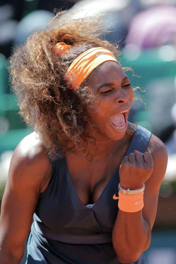 Serena Williams of the U.S. clenches her fist after scoring against Russia's Svetlana Kuznetsova in their quarterfinal match at the French Open tennis tournament, at Roland Garros stadium in Paris, Tuesday June 4, 2013. Photo: Christophe Ena, AP / AP