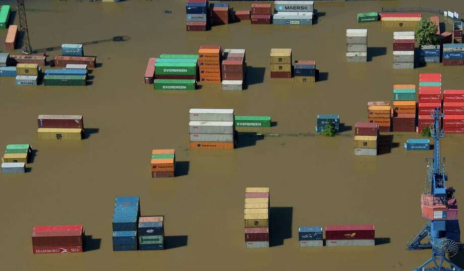 TOPSHOTS Aerial view shows a flooded container storage facility in Riesa, eastern Germany, on June 5, 2013. German, Czech and Austrian river cities braced for rising flood waters, evacuating thousands and boosting defences along the swollen Elbe and Danube, after inundations from heavy rains left 11 people dead.  AFP PHOTO / JOHANNES EISELEJOHANNES EISELE/AFP/Getty Images Photo: JOHANNES EISELE, AFP/Getty Images / AFP
