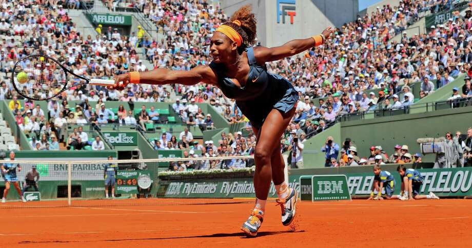 Serena Williams, of the U.S, reaches for the ball as she plays Russia's Svetlana Kuznetsova during their quarterfinal match of the French Open tennis tournament at the Roland Garros stadium Tuesday, June 4, 2013 in Paris. Photo: Michel Euler, AP / AP