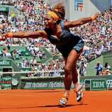 Serena Williams, of the U.S, reaches for the ball as she plays Russia's Svetlana Kuznetsova during their quarterfinal match of the French Open tennis tournament at the Roland Garros stadium Tuesday, June 4, 2013 in Paris.