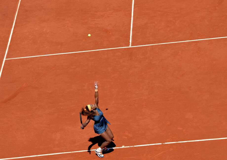 TOPSHOTS USA's Serena Williams serves to Russia's Svetlana Kuznetsova during their French Tennis Open quarter final match at the Roland Garros stadium in Paris, on June 4,  2013. AFP PHOTO / MIGUEL MEDINAMIGUEL MEDINA/AFP/Getty Images Photo: MIGUEL MEDINA, AFP/Getty Images / AFP