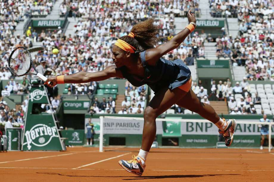 TOPSHOTS USA's Serena Williams returns to Russia's Svetlana Kuznetsova during their French Tennis Open quarter final match at the Roland Garros stadium in Paris, on June 4,  2013. AFP PHOTO / PATRICK KOVARIKPATRICK KOVARIK/AFP/Getty Images Photo: PATRICK KOVARIK, AFP/Getty Images / AFP