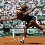 TOPSHOTS USA's Serena Williams returns to Russia's Svetlana Kuznetsova during their French Tennis Open quarter final match at the Roland Garros stadium in Paris, on June 4,  2013. AFP PHOTO / PATRICK KOVARIKPATRICK KOVARIK/AFP/Getty Images