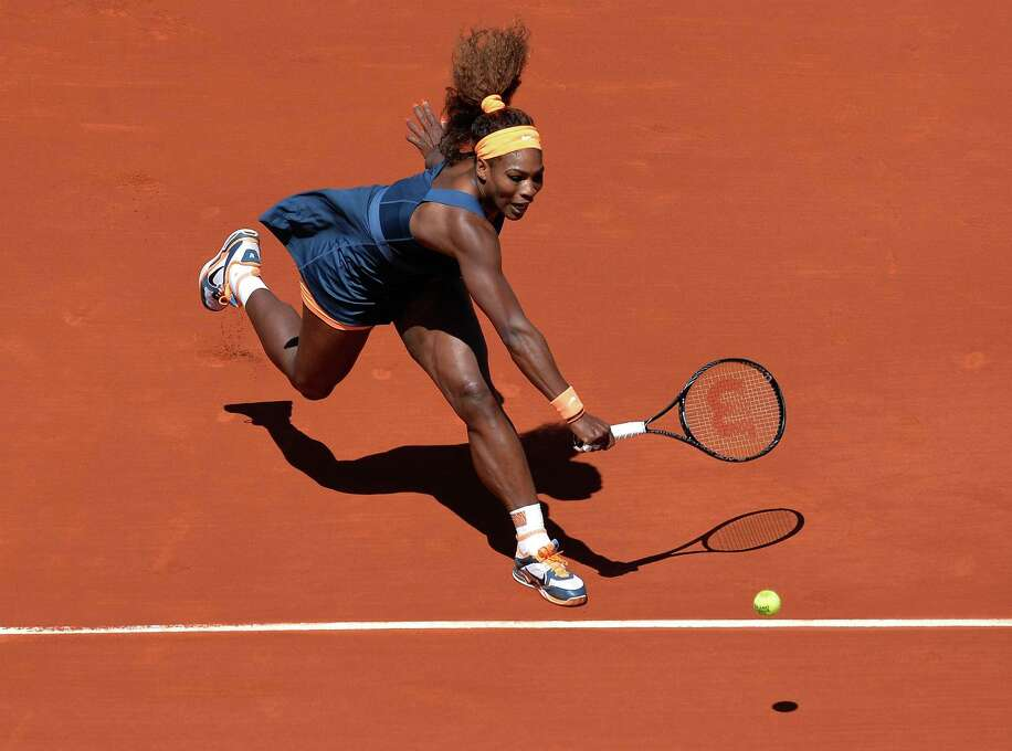 TOPSHOTS USA's Serena Williams returns to Russia's Svetlana Kuznetsova during their French Tennis Open quarter final match at the Roland Garros stadium in Paris, on June 4,  2013. AFP PHOTO / MIGUEL MEDINAMIGUEL MEDINA/AFP/Getty Images Photo: MIGUEL MEDINA, AFP/Getty Images / AFP
