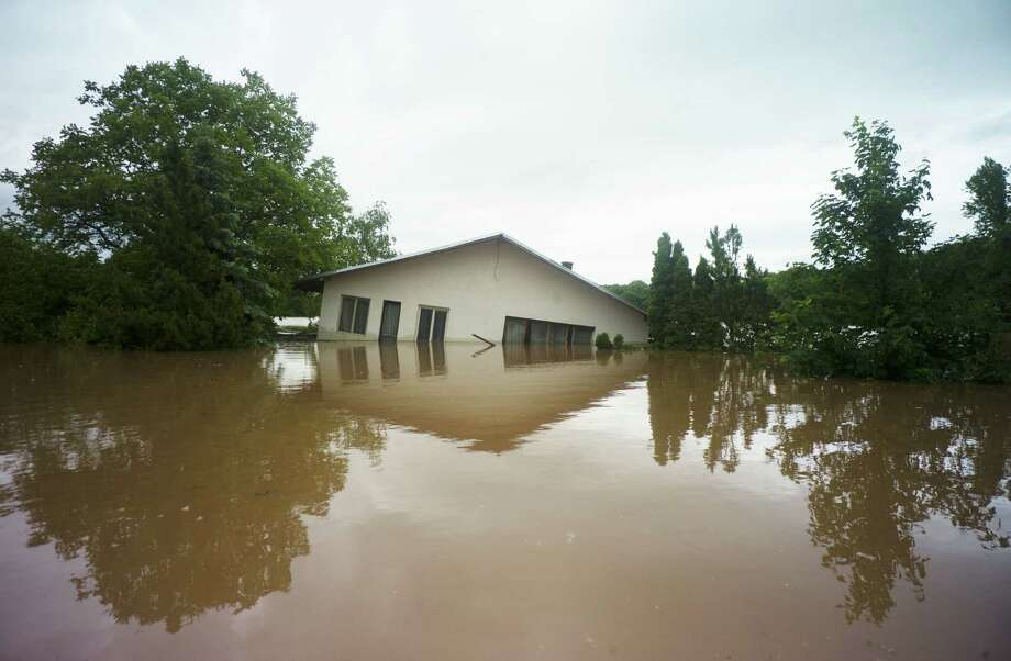 TOPSHOTS A house is flooded by the river Vltava in Kly, near Melnik, Czech Republic, on June 4, 2013. Torrential rain and heavy flooding hit central Europe. AFP PHOTO / MICHAL CIZEKMICHAL CIZEK/AFP/Getty Images Photo: MICHAL CIZEK, AFP/Getty Images / AFP