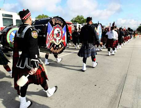 Members of the pipe and drum corps march up Kirby during the procession to Reliant Stadium during a memorial service honoring Houston firefighters Robert Bebee, Robert Garner, Matthew Renaud, and Anne Sullivan at Reliant Stadium Wednesday, June 5, 2013, in Houston. The four firefighters died in a 5-alarm fire while searching for people they thought might be trapped inside a burning motel and restaurant last Friday. Photo: Karen Warren, Houston Chronicle / © 2013  Houston Chronicle