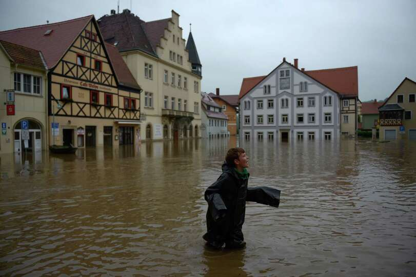 TOPSHOTS A boy stands in the flooded city of Wehlen, in eastern Germany, on June 4, 2013. Torrential
