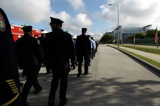 Members of the Houston Fire Department march up Kirby towards Reliant Stadium during a memorial service honoring Houston firefighters Robert Bebee, Robert Garner, Matthew Renaud, and Anne Sullivan at Reliant Stadium Wednesday, June 5, 2013, in Houston. The four firefighters died in a 5-alarm fire while searching for people they thought might be trapped inside a burning motel and restaurant last Friday. Photo: Karen Warren, Houston Chronicle / © 2013  Houston Chronicle