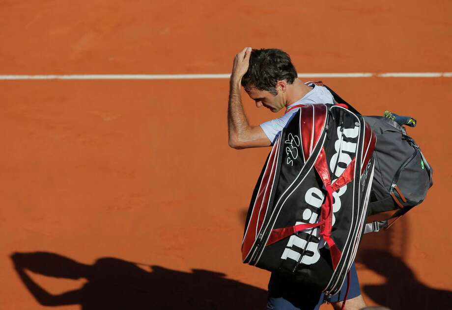 Switzerland's Roger Federer leaves the court after losing to France's Jo-Wilfried Tsonga during their quarterfinal match of the French Open tennis tournament at the Roland Garros stadium Tuesday, June 4, 2013 in Paris. Tsonga won 7-5, 6-3, 6-3. Photo: Michel Spingler, AP / AP