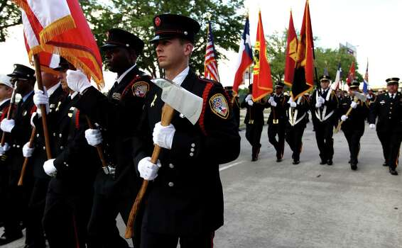 Firefighters march up Kirby during the procession  leading to a memorial service honoring Houston firefighters Robert Bebee, Robert Garner, Matthew Renaud, and Anne Sullivan at Reliant Stadium Wednesday, June 5, 2013, in Houston. The four firefighters died in a 5-alarm fire while searching for people they thought might be trapped inside a burning motel and restaurant last Friday. Photo: Karen Warren, Houston Chronicle / © 2013  Houston Chronicle