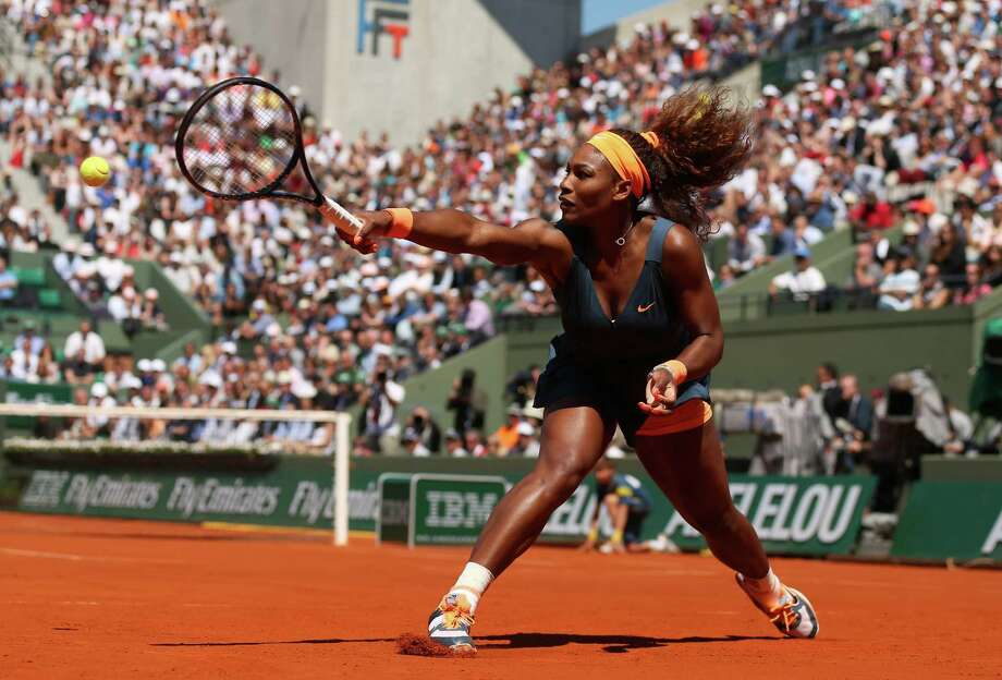PARIS, FRANCE - JUNE 04:  Serena Williams of United States of America plays a backhand during her Women's Singles Quarter-Final match against Svetlana Kuznetsova of Russia on day ten of the French Open at Roland Garros on June 4, 2013 in Paris, France.  (Photo by Matthew Stockman/Getty Images)  *** BESTPIX *** Photo: Matthew Stockman, Getty Images / 2013 Getty Images