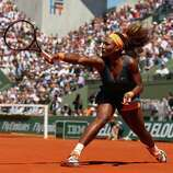 PARIS, FRANCE - JUNE 04:  Serena Williams of United States of America plays a backhand during her Women's Singles Quarter-Final match against Svetlana Kuznetsova of Russia on day ten of the French Open at Roland Garros on June 4, 2013 in Paris, France.  (Photo by Matthew Stockman/Getty Images)  *** BESTPIX ***