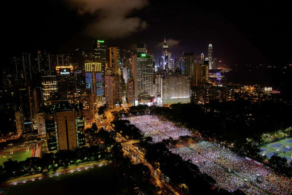 TOPSHOTS People are seen gathered at Victoria Park during a candlelight vigil held to mark the 24th anniversary of the 1989 crackdown at Tiananmen Square, in Hong Kong on June 4, 2013. More than 100,000 people were expected to attend the candlelight vigil in the former British colony which is the only place in China where the brutal military intervention that ended weeks of nationwide democracy protests in 1989 is openly commemorated. AFP PHOTO / Philippe LopezPHILIPPE LOPEZ/AFP/Getty Images
