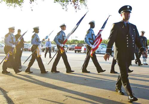 Houston Police Department honor guard take their place before a memorial service honoring Houston firefighters Robert Bebee, Robert Garner, Matthew Renaud, and Anne Sullivan at Reliant Stadium Wednesday, June 5, 2013, in Houston. The four firefighters died in a 5-alarm fire while searching for people they thought might be trapped inside a burning motel and restaurant last Friday. Photo: Brett Coomer, Houston Chronicle / © 2013  Houston Chronicle