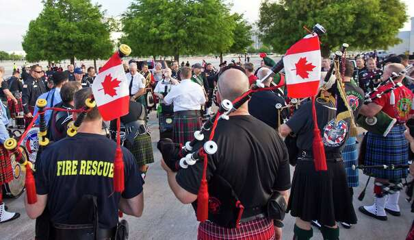 Canadian pipes men practice with other bagpipe corps from through out the U.S. before a memorial service honoring Houston firefighters Robert Bebee, Robert Garner, Matthew Renaud, and Anne Sullivan at Reliant Stadium Wednesday, June 5, 2013, in Houston. The four firefighters died in a 5-alarm fire while searching for people they thought might be trapped inside a burning motel and restaurant last Friday. Photo: Brett Coomer, Houston Chronicle / © 2013  Houston Chronicle