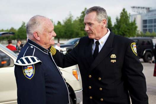 Retired Houston Fire Department retired firefighter Terry Crawford, left, and Houston Fire Department Chief Terry Garrison speak before a memorial service honoring Houston firefighters Robert Bebee, Robert Garner, Matthew Renaud, and Anne Sullivan at Reliant Stadium Wednesday, June 5, 2013, in Houston. The four firefighters died in a 5-alarm fire while searching for people they thought might be trapped inside a burning motel and restaurant last Friday. Photo: Brett Coomer, Houston Chronicle / © 2013  Houston Chronicle