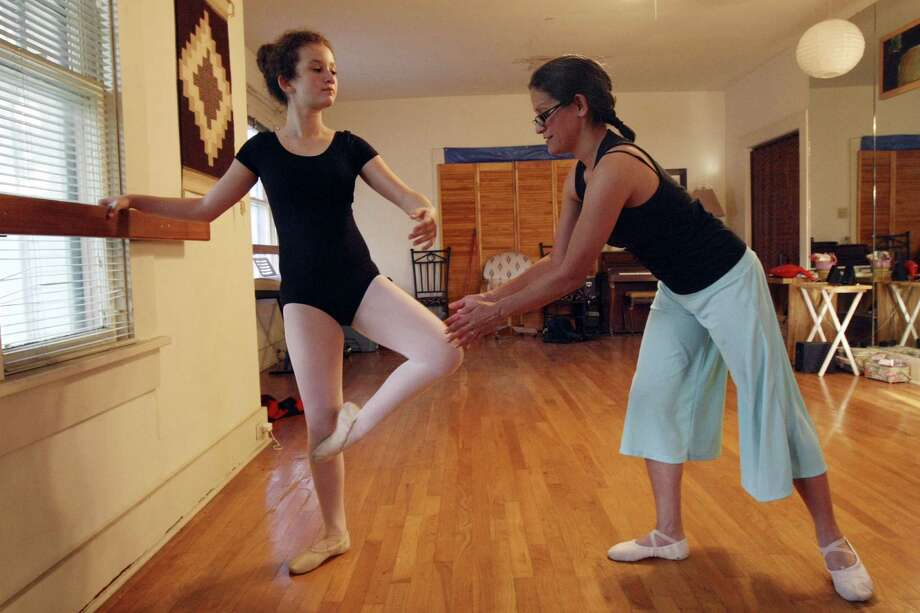 Paulina Rodriguez, 11, warms up during Jacque Salame's ballet class last month. Centro Para la Semilla combines the arts with educational programs in nutrition and gardening. Photo: Helen L. Montoya / Conexión