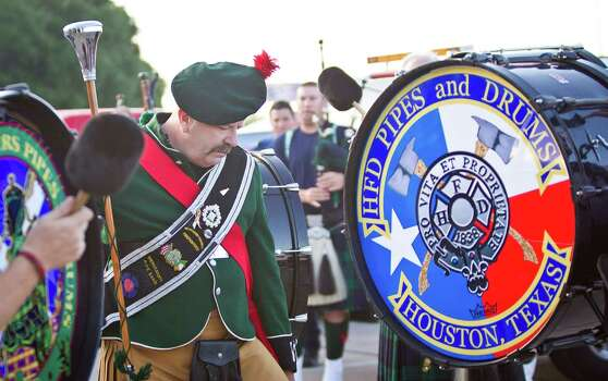 Brian Brendel, a battalion chief from Northern Virginia instructs the massive bag pipe corp made up of bagpipe an drum corps from through out the U.S. and Canada before a memorial service honoring Houston firefighters Robert Bebee, Robert Garner, Matthew Renaud, and Anne Sullivan at Reliant Stadium Wednesday, June 5, 2013, in Houston. The four firefighters died in a 5-alarm fire while searching for people they thought might be trapped inside a burning motel and restaurant last Friday. Photo: Brett Coomer, Houston Chronicle / © 2013  Houston Chronicle