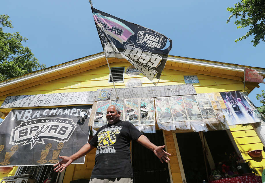 San Antonio Spurs fan Leonardo Flores, 63, stands on the porch of his west side house, Tuesday, June 4, 2013. The retired school custodian has decorated his house, on the 200 block of SW 25th Street, with Spurs memorabilia for more than 25 years. Photo: JERRY LARA, San Antonio Express-News / © 2013 San Antonio Express-News