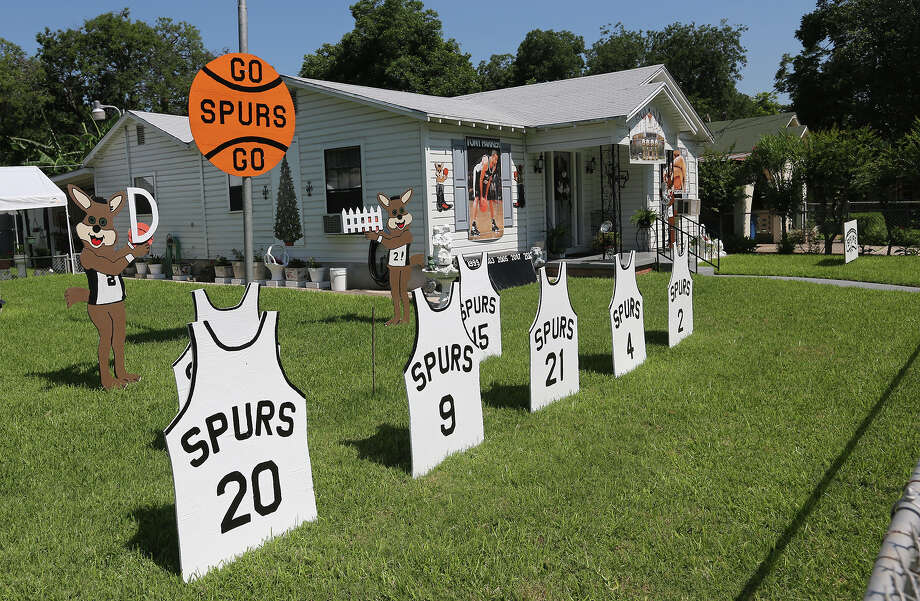 A fan on the 1500 block of S.W. 18th Street goes all out supporting the San Antonio Spurs, Tuesday, June 4, 2013. Photo: JERRY LARA, San Antonio Express-News / © 2013 San Antonio Express-News