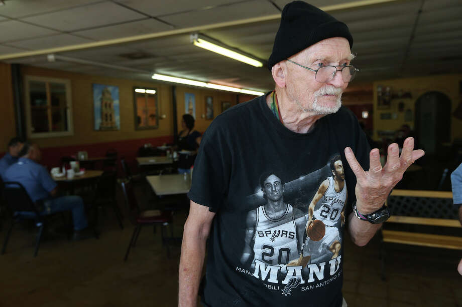 Sporting an old Manu Ginobili tee-shirt, Fred Schimmelpfennig, 81, (cq), talks about the upcoming San Antonio Spurs/Miami Heat NBA finals, after breakfast at Oblate Cafe, Tuesday, June 4, 2013.Share your Spurs fan photos here. Photo: JERRY LARA, San Antonio Express-News / © 2013 San Antonio Express-News