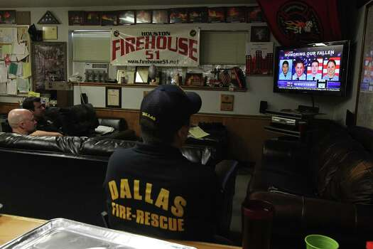 Dallas Firefighters volunteering at Station #51 view the start of the Houston Firefighter Memorial Service on TV on June 5, 2013. Photo: Houston Chronicle