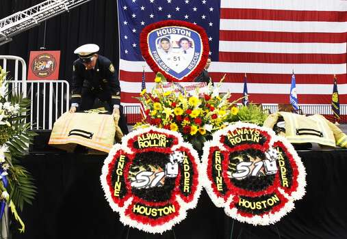Thousands turned out for a memorial service to honor the four Houston firefighters who were killed battling a 5-alarm blaze at a Southwest Houston motel on Friday. Photo: Cody Duty/Houston Chronicle Photo: Houston Chronicle