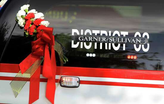 "Black tape covers the sign ""District 68"" on the back of a vehicle during a memorial service honoring Houston firefighters Robert Bebee, Robert Garner, Matthew Renaud, and Anne Sullivan at Reliant Stadium Wednesday, June 5, 2013, in Houston. The four firefighters died in a 5-alarm fire while searching for people they thought might be trapped inside a burning motel and restaurant last Friday. Photo: Karen Warren, Houston Chronicle / © 2013  Houston Chronicle"