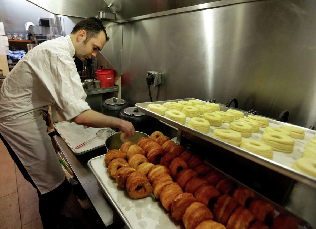 This June 3, 2013 photo shows chef Dominique Ansel making cronuts, a croissant-donut hybrid, at the Dominique Ansel Bakery in New York. Ansel makes only 200 to 250 Cronuts every morning and has been selling out within an hour.