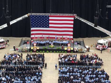Thousands turned out for a memorial service to honor the four Houston firefighters who were killed battling a 5-alarm blaze at a Southwest Houston motel on Friday. Photo: Houston Chronicle