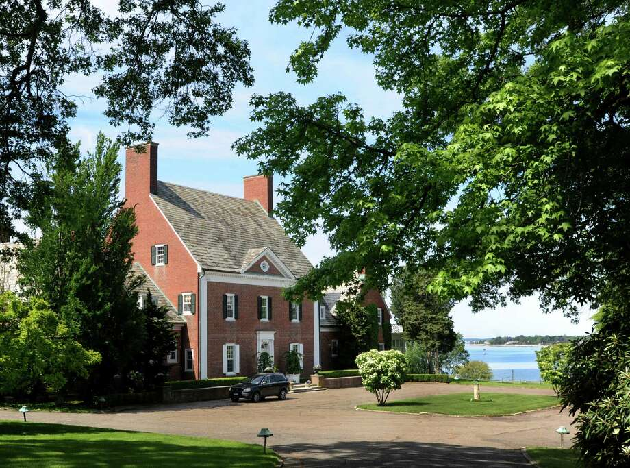 This house for sale at 1078 Sasco Hill Road in Fairfield, Conn. is listed at $9.7 million. The property overlooks Sasco Beach and has a western view Long Island Sound. Photo: Cathy Zuraw / Connecticut Post