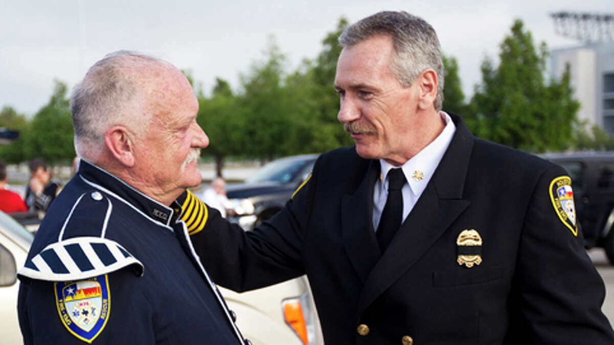Retired Houston Fire Department retired firefighter Terry Crawford, left, and Houston Fire Department Chief Terry Garrison speak before a memorial service honoring Houston firefighters Robert Bebee, Robert Garner, Matthew Renaud, and Anne Sullivan at Reliant Stadium Wednesday, June 5, 2013, in Houston. The four firefighters died in a 5-alarm fire while searching for people they thought might be trapped inside a burning motel and restaurant last Friday. ( Brett Coomer / Houston Chronicle )