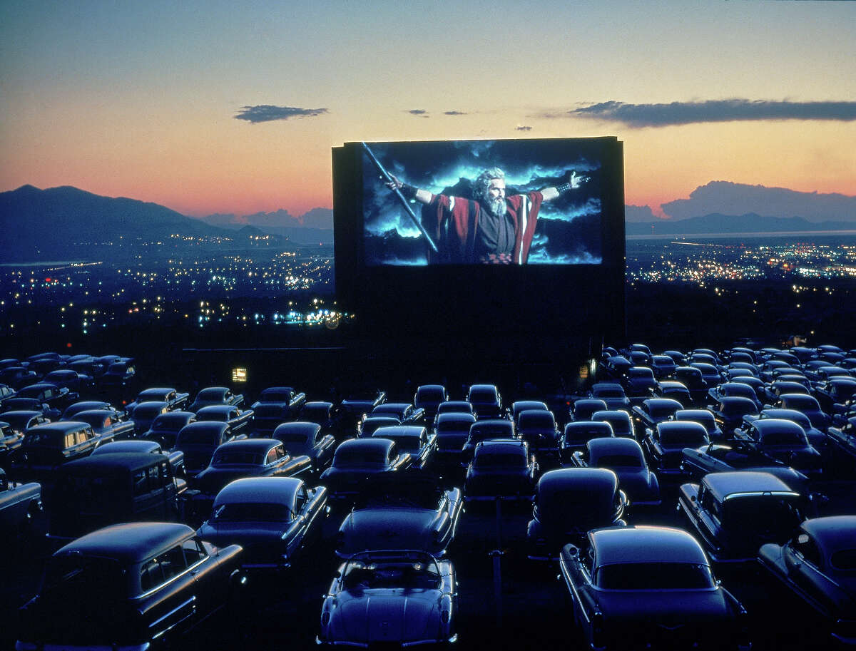 On June 6, 1933, America's first drive-in movie theater opened in Camden, New Jersey. Once a source of great summer amusement drive-ins began their decline in the 1970s thanks to increasing real estate values, day-light savings time and the popularity of the bucket seat in automobiles.Here's a look back at 80 years of drive-ins.Above, Charlton Heston parts the Red Sea at a Utah drive-in, 1958.