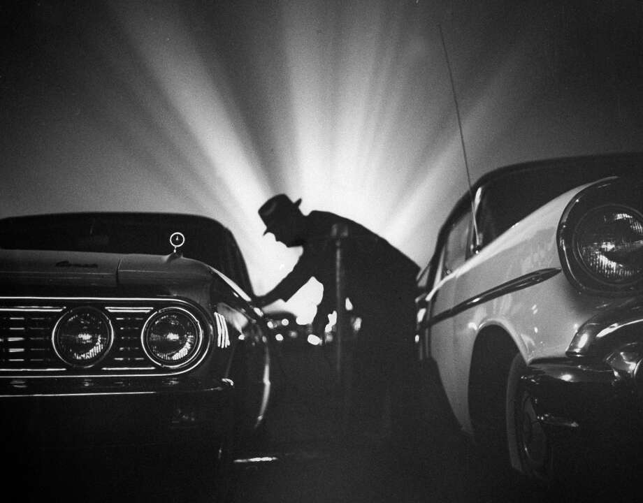 A detective checking cars to make sure teenagers are behaving. Photo: A. Y. Owen, Time & Life Pictures/Getty Image / A. Y. Owen