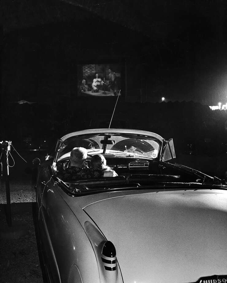 A young couple cuddling while watching a movie at a drive-in in 1951. Photo: Francis Miller, Time & Life Pictures/Getty Image / Time & Life Pictures