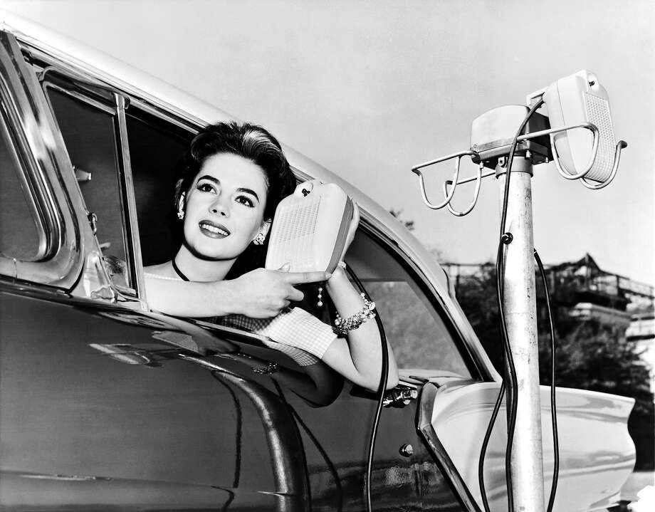 Natalie Wood displays the new drive in-movie speakers as she leans out of her car window, Hollywood, California, 1957. Photo: Underwood Archives, Getty Images / ©Underwood Archives
