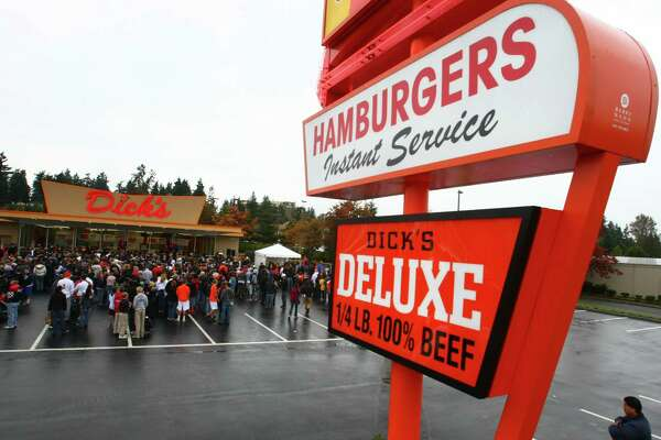 Dick's burgers: Not the juiciest patty ever, but a burger, shake and limp, salty fries at this orange drive-in is a quintessential Seattle experience. Or Edmonds, pictured, site of the newest Dick's.