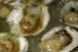 """Olympia oysters , mostly cultivated in the Totten and Little Skookum inlets, are known for a """"sweet, metallic, celery-salt flavor,"""" says  Rowan Jacobsen in The Oyster Guide ."""